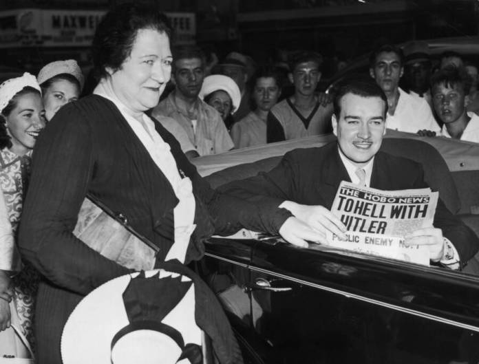 William Hitler With Newspaper In Car