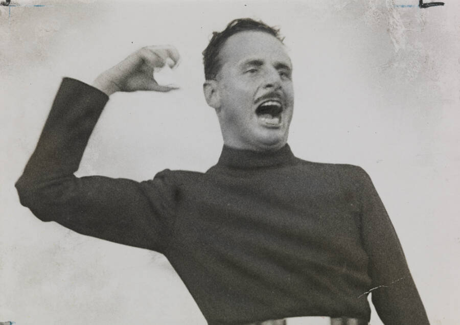 Mosley Speaking With His Arm Raised