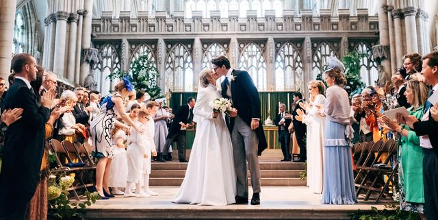 Harper's Bazaar is one of my Most Loved Sites for Weddings. Pictured: Bride and Groom kissing at a church alter