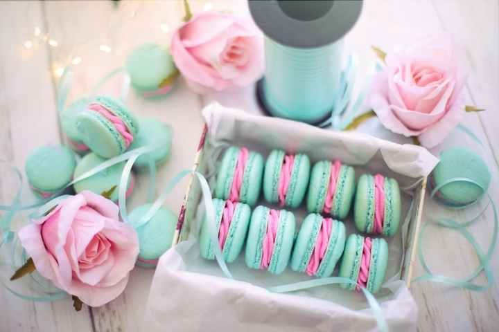 Sweets and other edible contents are perfect items to include when building a welcome bag. Pictured: Robbin's egg blue ribbon with blue and pink macaroons