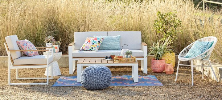Outdoor furniture vignette with pops of white and blue
