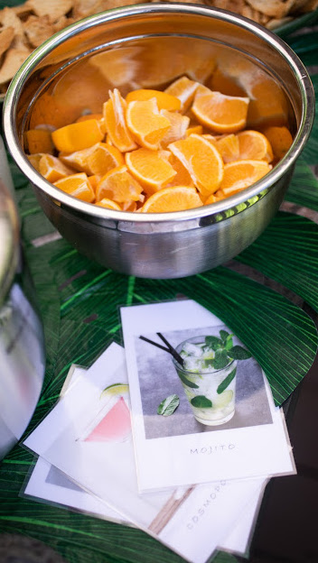 Orange Slices in Metal Bowl and Three Cocktail Recipe Cards