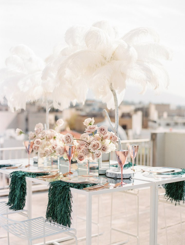 Tablescape design with tall white feather centerpieces and pink rose gold accents