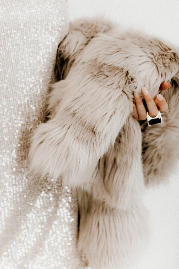 Woman holding fur coat