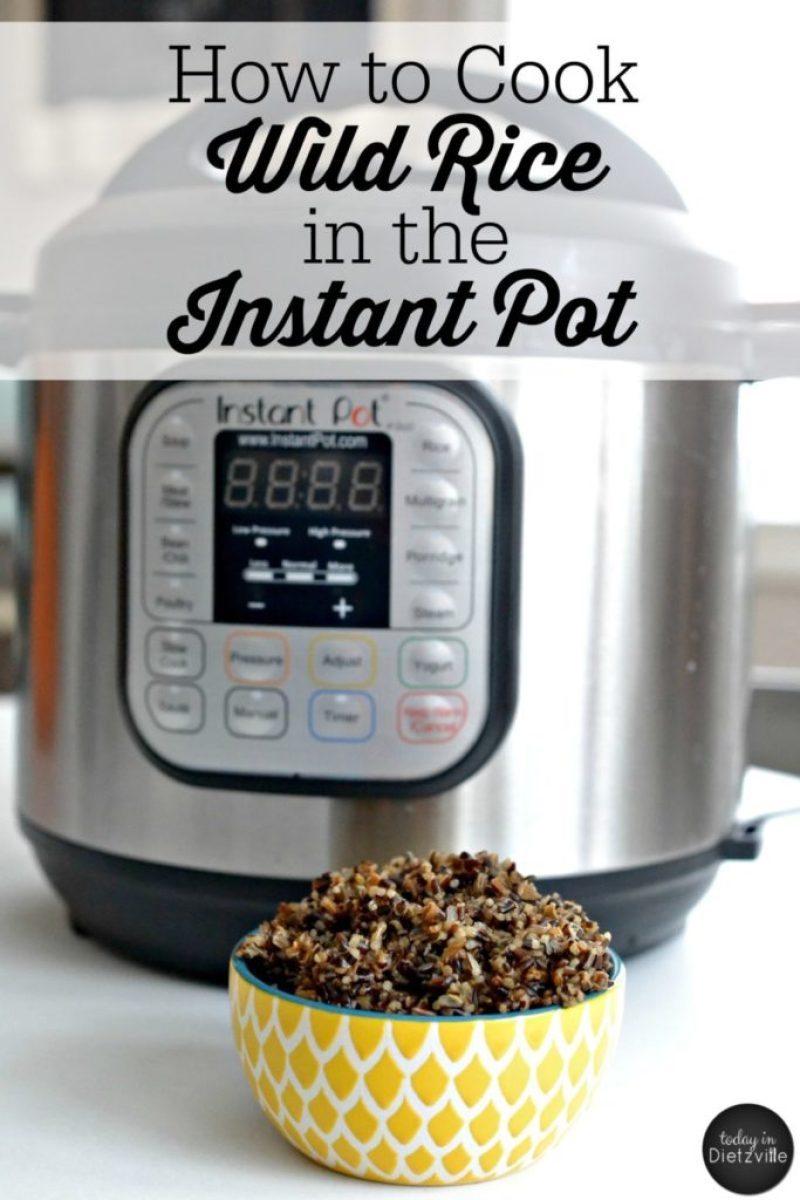 yellow bowl of wild rice cooked in instant pot with instant pot in background