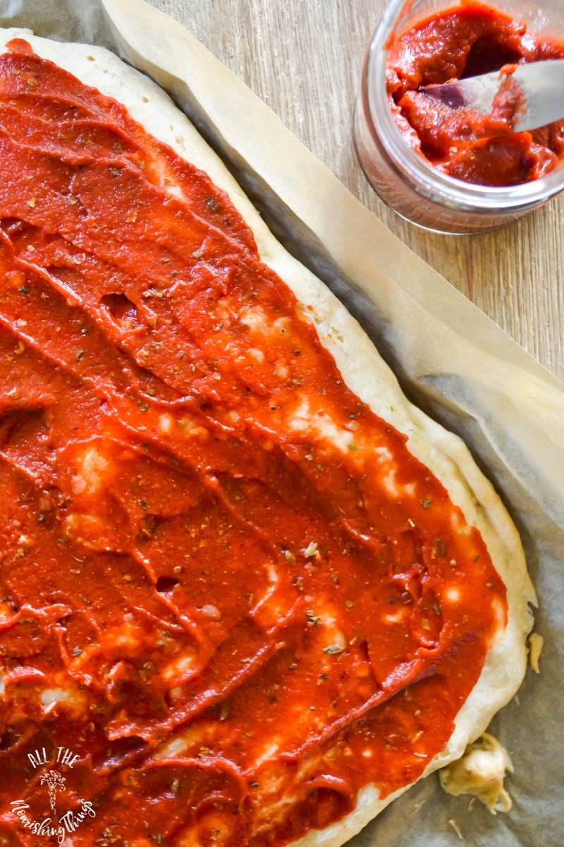 easy sugar-free pizza sauce spread on crust