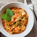 white bowl of instant pot jambalaya garnished with fresh sage leaves