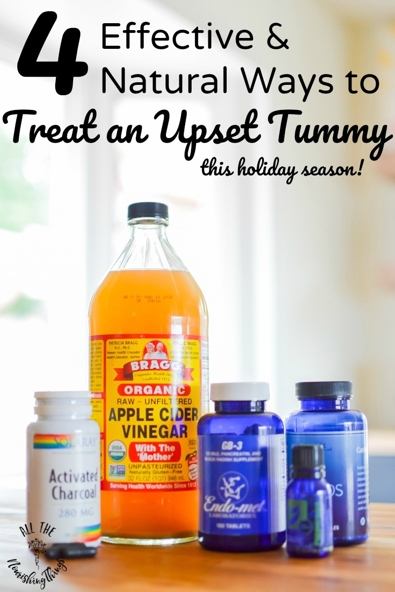 bottles of activated charcoal, digestive enzymes, and apple cider vinegar to naturally treat upset stomach
