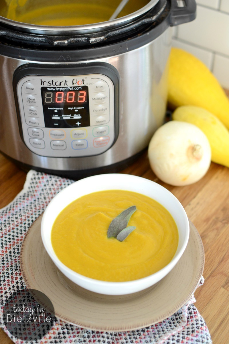 white bowl of yellow instant pot blended soup