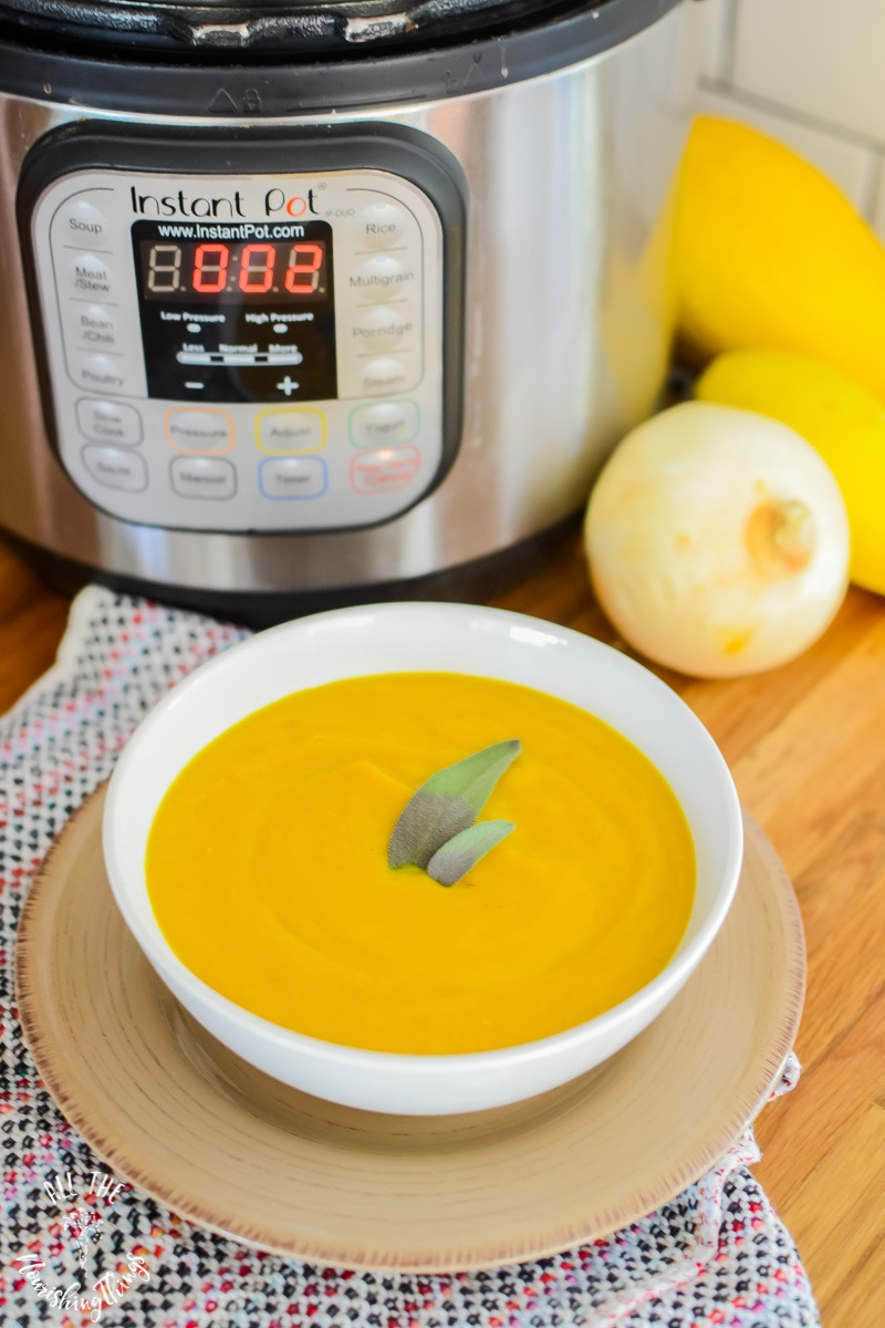 bright yellow blended soup in white bowl with Instant Pot