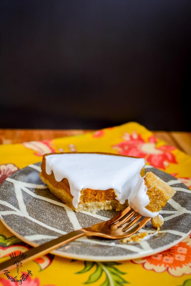 slice of instant pot paleo pumpkin pie with bite of pie on fork