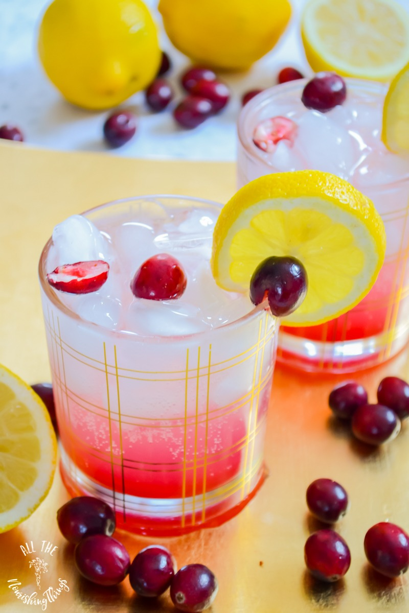 keto cranberry lemon spritzer with lemons and cranberries