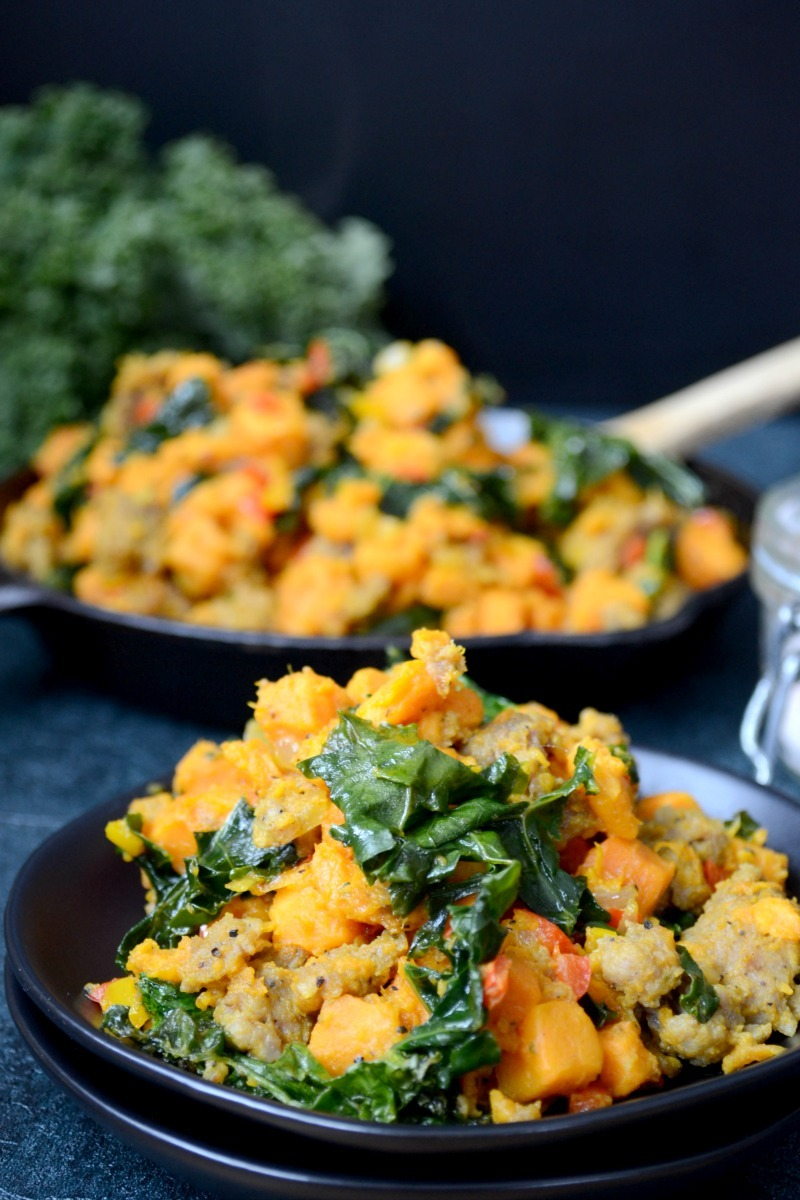 colorful breakfast hash with greens and black background