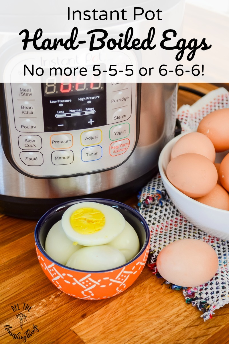 no-fail hard-boiled eggs in orange bowl sitting in front of an instant pot