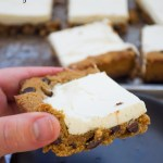 hand holding chocolate chip cookie cheesecake bar