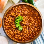 wooden bowl of instant pot bacon jalapeno baked beans