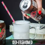hand pouring root beer zevia into frosty mug to make keto root beer float
