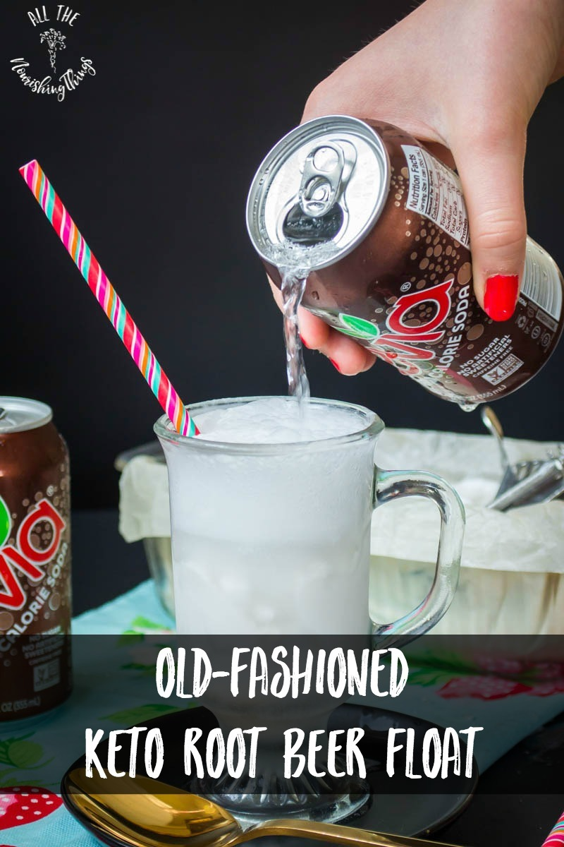 hand pouring root beer zevia into frosted mug for old-fashioned keto root beer float