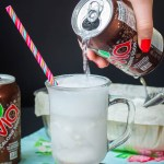 hand pouring root beer into frosty mug for keto root beer float