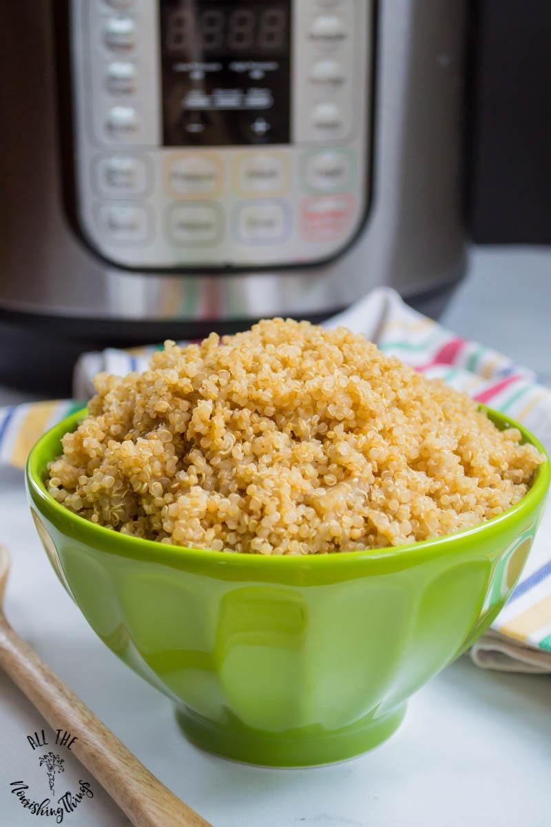 green bowl of instant pot quinoa
