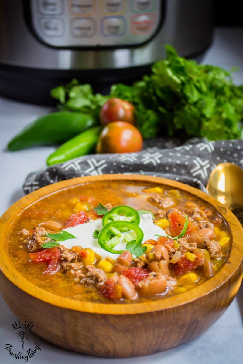 dump and cook instant pot taco soup in wooden bowl