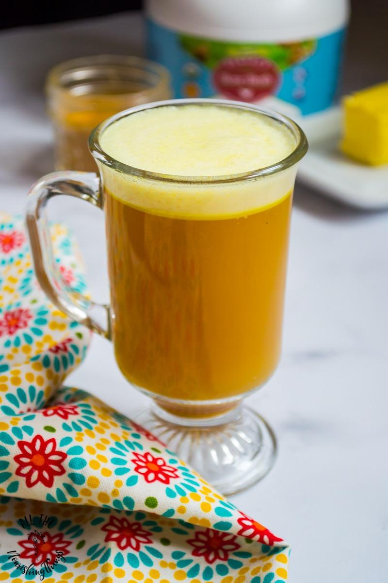 clear mug of instant turmeric bone broth latte
