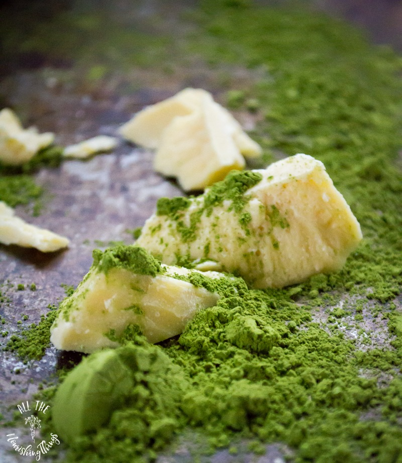 chunks of cacao butter with green matchinga powder