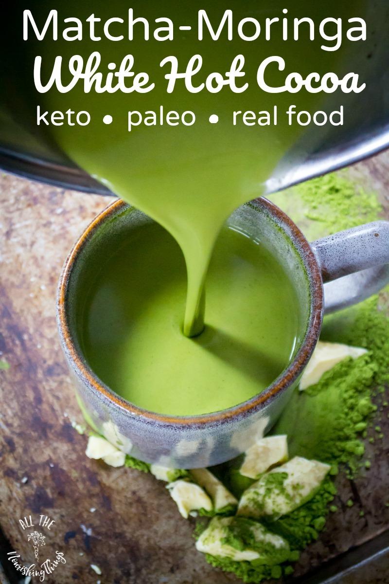 pouring green matcha moringa white hot cocoa into mug with text overlay