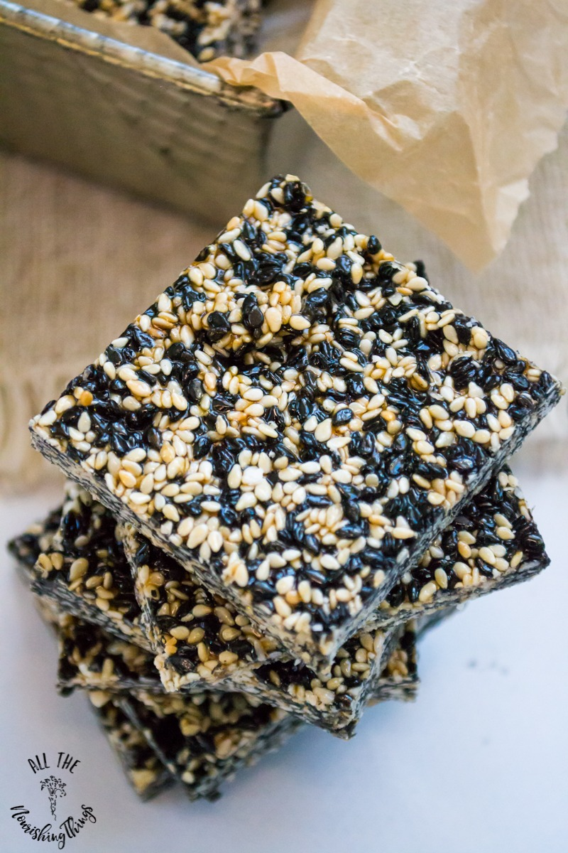 close-up image of paleo sesame ginger candy made with black and white sesame seeds
