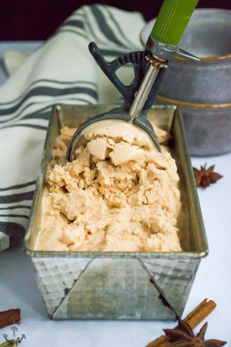 dairy-free and vegan keto chai ice cream in metal tin with vintage ice cream scoop