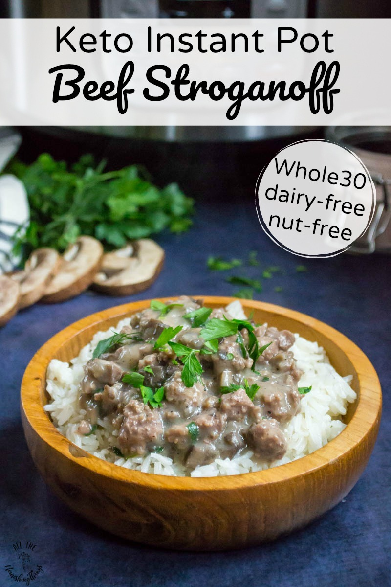 wooden bowl of keto instant pot beef stroganoff on rice with text overlay