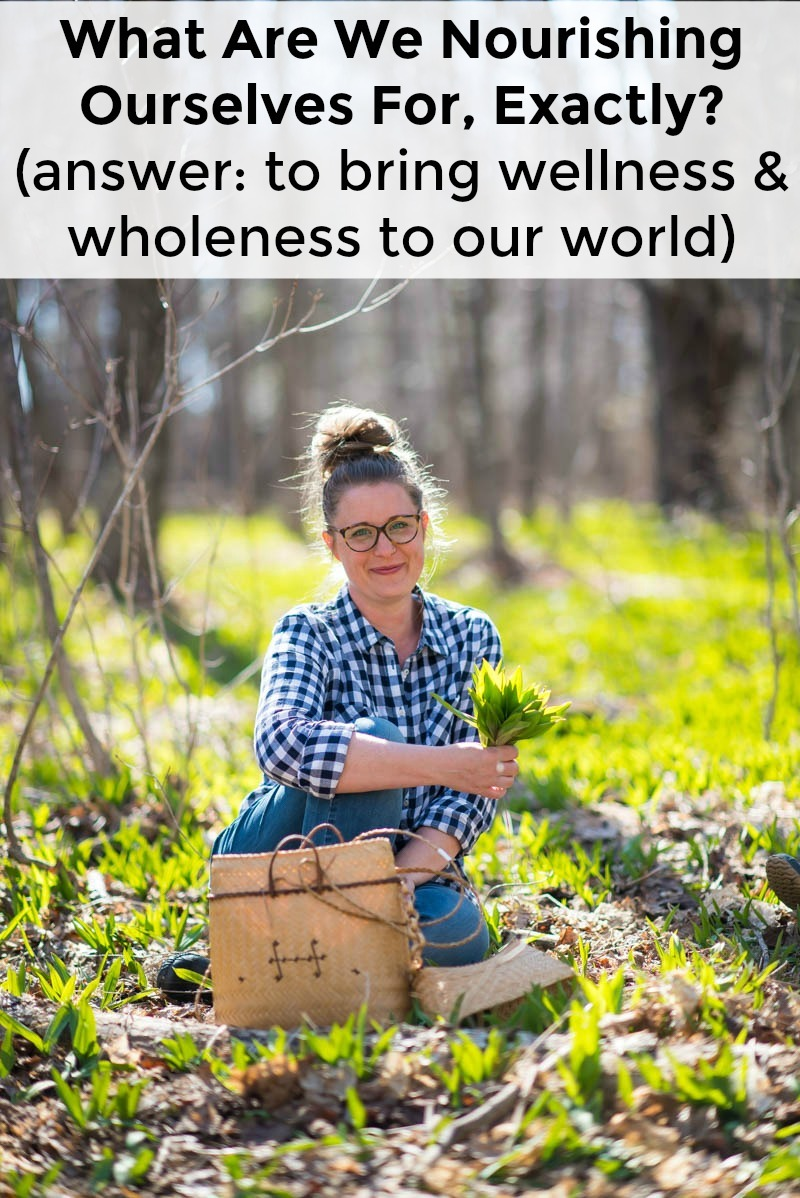 lindsey dietz in a blue gingham shirt sitting in a woodland of wild leeks and holding a bouquet of wild leeks in her hand