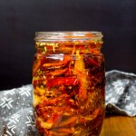 jar of red homemade sun-dried tomatoes packed in olive oil