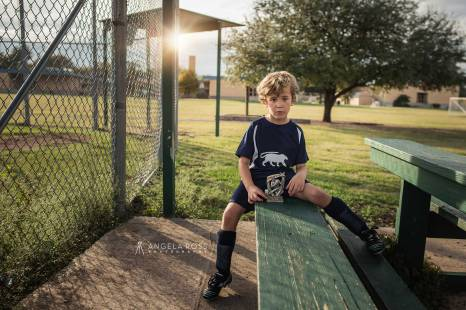 boy-with-trophy-angela-ross-photography