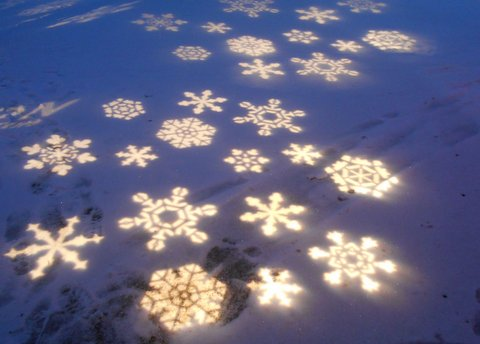 A snowflake path leads to the tree lights.
