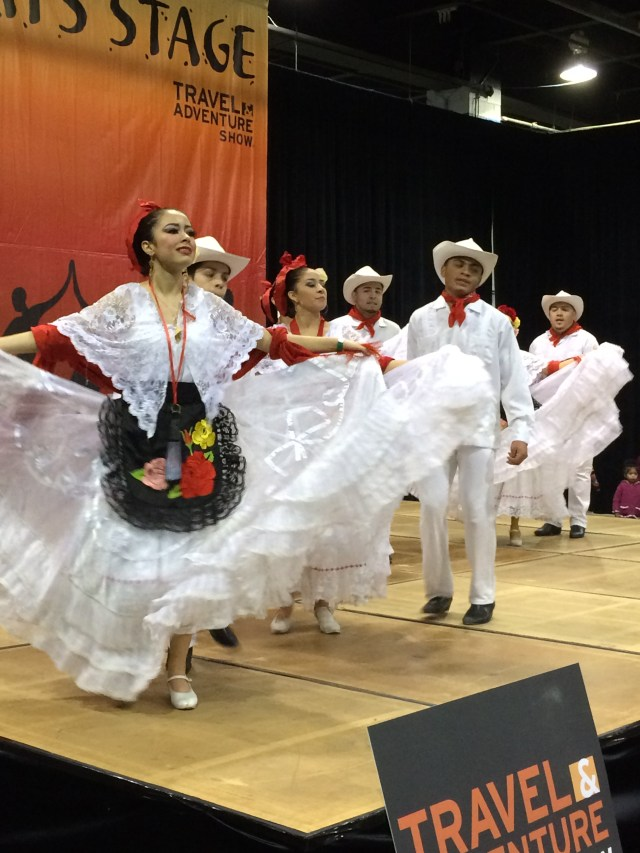 Mexican folkloric dancers twirl and swirl at the Travel & Adventure Show.