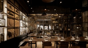 A restaurant dining room decorated in woods, dried botanicals and muted colors. Tzuco restaurant in Chicago by Diego Padilla.