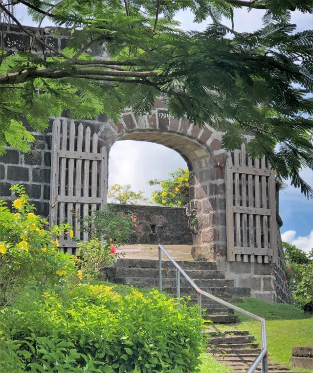 Stairs lead to a stone archway and entrance
