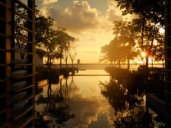 The sun sets beyond the reflection pool at NIZUC Resort & Spa, Cancun.