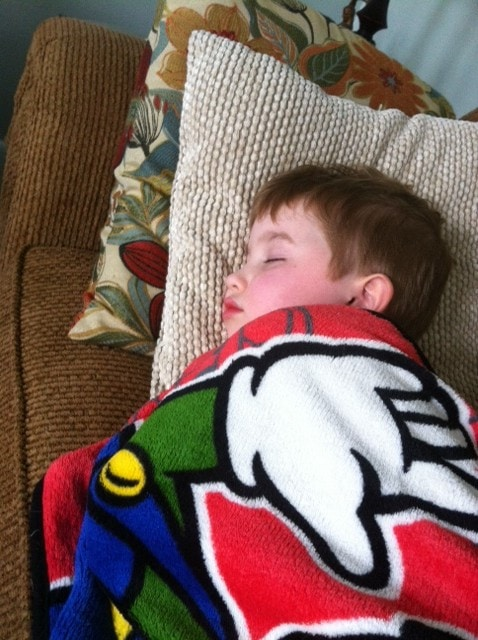 Evan snuggled in his Mario blanket