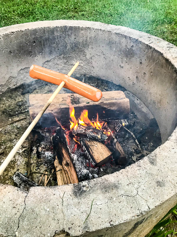 Cooking hot dogs over the fire
