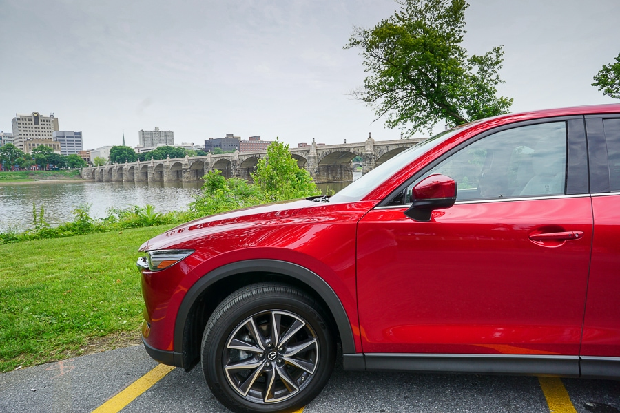 Mazda CX-5 overlooking the railroad bridge to Harrisburg