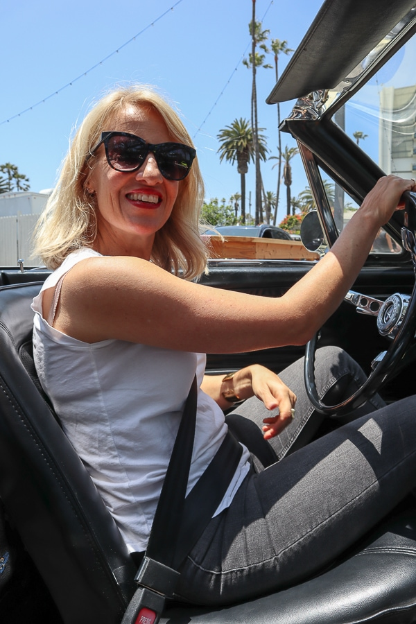 Amelia behind the wheel of the Mustang