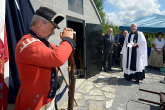 The re-consecration of the Johnson family crypt with a Light Infantryman of the 2nd battalion, King's Royal Yorkers resting on his arms reversed before the regiment's Colours, August 23, 2014. (Anonymous photographer)