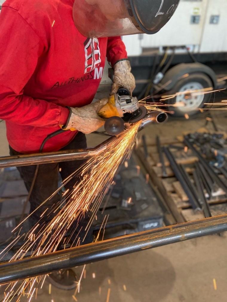 All Things Metal Woman female welder sparks grinder steel iron ironwork