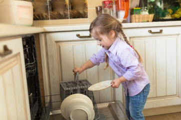 children and chores - helping with the dishwasher