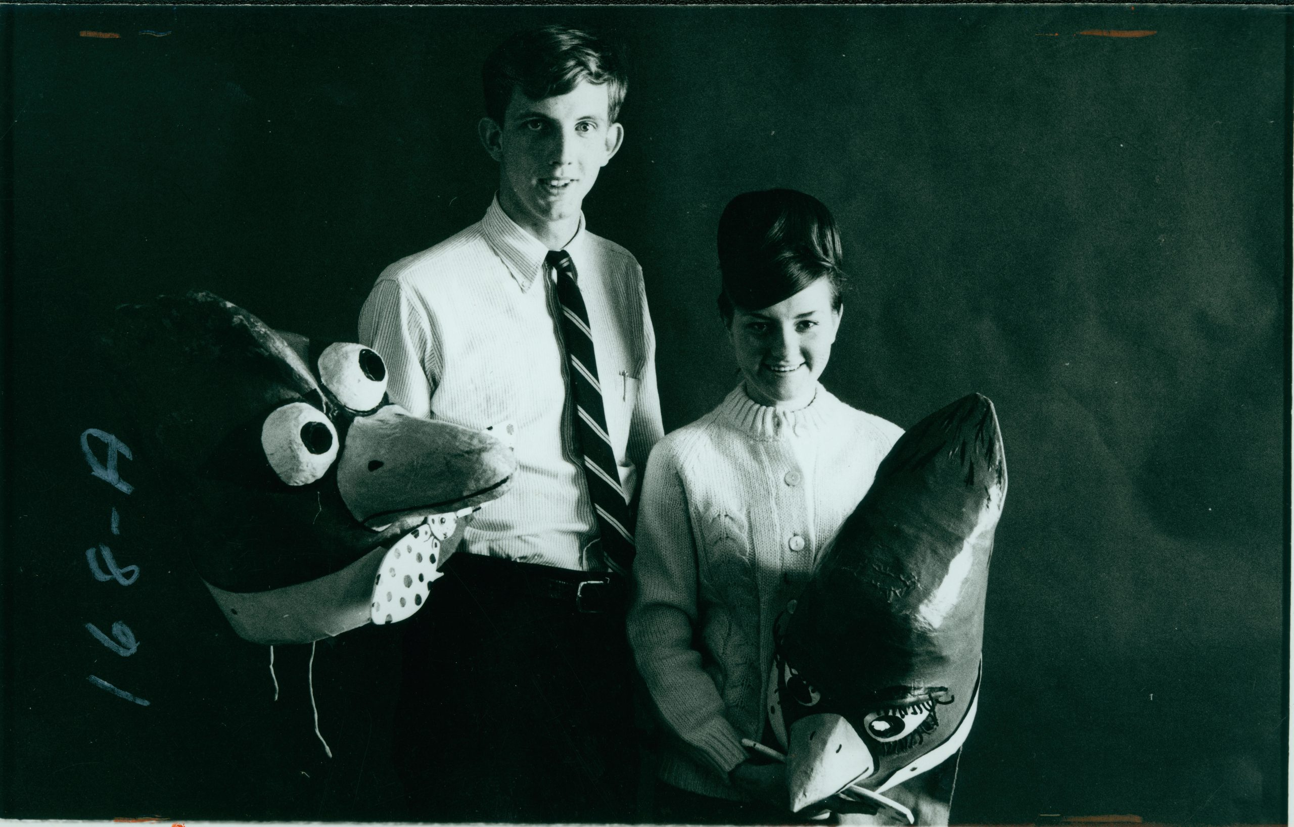 1964 CB and Ladybird headson humans holding mask
