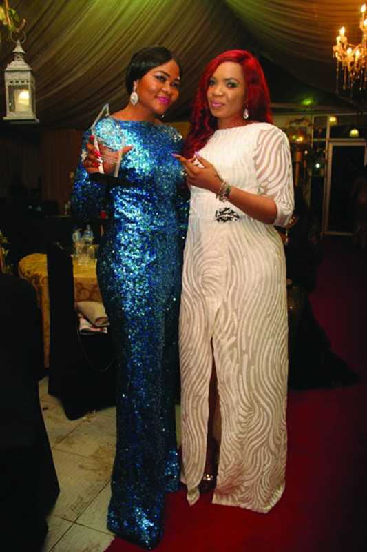 Eunice Efole with a friend