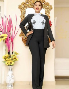 Tonto Dike poses on suit