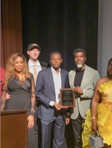 Reno Omokri posses with award.